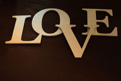情人节和圣诞节背景 葡萄酒木题字爱 题字的构成对华伦泰` s天 免版税库存图片
