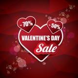 情人节心脏形状销售标签或贴纸在抽象红色背景与迷离点燃 传染媒介销售海报或 图库摄影