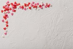 情人节糖果心脏由红色制成,白色,桃红色洒 免版税库存图片