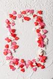 情人节糖果心脏由红色制成,白色,桃红色洒 图库摄影