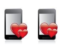 情人节重点和smartphone 免版税库存照片