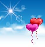 情人节飞行的两个光滑的心脏气球在蓝色 库存图片