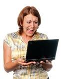 情感女孩膝上型计算机 免版税图库摄影