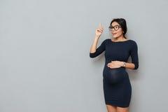 情感怀孕的企业夫人有一个想法 免版税库存图片