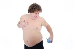 情节 肥胖人 赤裸和穿戴 免版税图库摄影