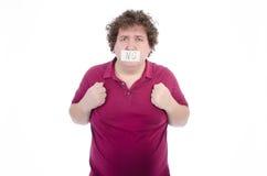 情节 肥胖人 赤裸和穿戴 免版税库存图片