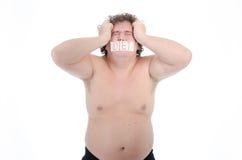 情节 肥胖人 赤裸和穿戴 库存照片