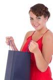 惊人的少妇纵向有购物袋的 免版税库存照片