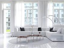 惊人的白色顶楼客厅内部 库存照片