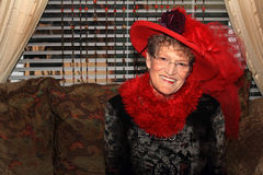 惊人的红色帽子夫人 库存照片