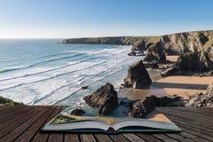 惊人黄昏日落Bedruthan步的风景图象在西部康沃尔郡海岸的在从开放故事书出来的页英国 库存照片