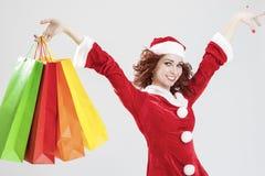 惊叹和有许多的愉快的白种人圣诞老人女孩五颜六色的Sho 库存照片