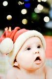 惊奇婴孩表面圣诞老人 免版税库存照片