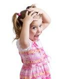 惊奇或惊奇的儿童女孩递拿着头 免版税库存图片