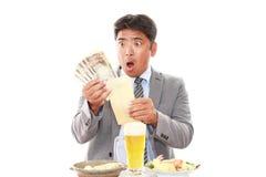 惊奇的亚洲生意人 库存照片