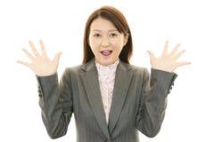 惊奇的女性办公室工作者 图库摄影