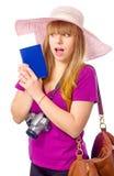 惊奇的妇女持与票的一本护照 免版税库存图片
