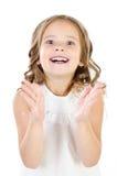 惊奇的愉快的可爱的小女孩画象被隔绝 免版税库存图片