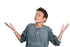 惊奇的青少年与胳膊打开。 免版税库存图片