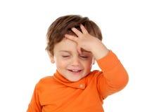 惊奇的婴孩用他的在头的手 图库摄影