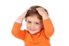 惊奇的婴孩用他的在头的手 免版税库存照片