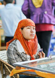 惠山少数女性供营商,三亚,中国 免版税库存照片