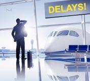 想念他的飞行的商人在机场 免版税库存照片