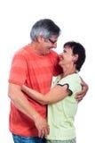 愉快中间变老的夫妇笑 免版税图库摄影