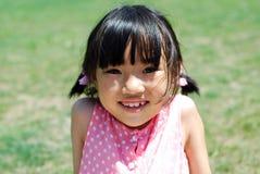 愉快亚裔的女孩一点 免版税库存照片