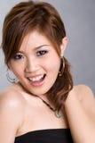 愉快亚裔的女孩 库存图片