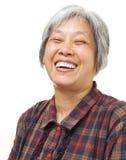 愉快亚洲老妇人的感受 免版税图库摄影