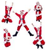 愉快圣诞老人服装男孩跳跃 免版税库存图片
