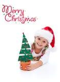 愉快圣诞节的女孩 免版税库存照片