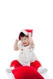 愉快地palying愉快的圣诞节的女孩 免版税库存图片