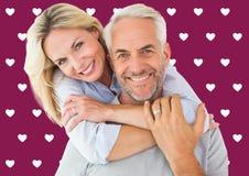 愉快夫妇身分和拥抱的综合图象 免版税库存图片