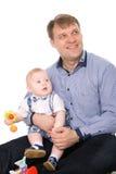 愉快婴孩美丽的逗人喜爱的父亲一点 库存照片