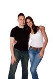 愉快微笑的夫妇拥抱 免版税图库摄影