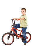 愉快心爱的自行车的男孩他的 图库摄影