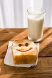 愉快敬酒和一杯牛奶 免版税库存照片