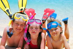 愉快海滩的潜水员 免版税库存图片