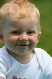 愉快男婴的表面 免版税库存图片