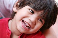 愉快男孩微笑的一点 免版税库存图片