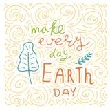 愉快的世界地球日 概念性手写的词组 手拉的印刷术海报 T恤杉手有学问的书法设计 免版税库存图片