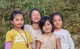 愉快的中国女孩在云南村庄  图库摄影