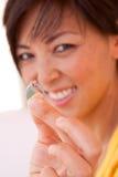 愉快的亚裔妇女被激发关于她的订婚 库存照片