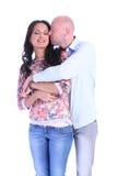 愉快的亲吻的夫妇画象  免版税图库摄影