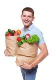 愉快的人举行请求用健康食物,杂货买家被隔绝 免版税库存图片