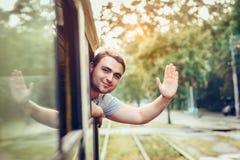愉快的人享用在城市使用公共交通工具 库存图片