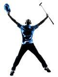愉快的人高尔夫球运动员打高尔夫球的跳跃剪影 免版税图库摄影