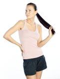 愉快的健康常设妇女年轻人 库存图片